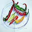 Hot peppers on violet glass plate