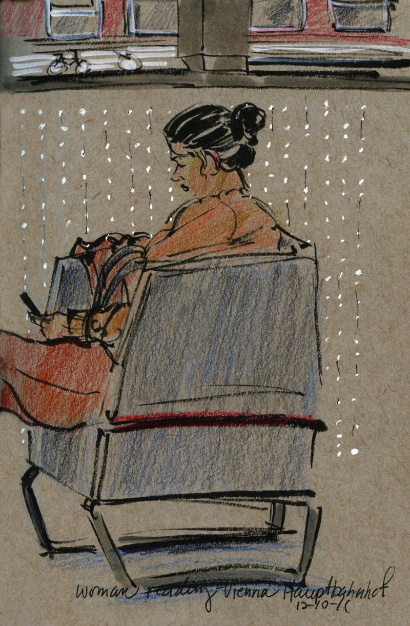 Woman waiting at vienna train station