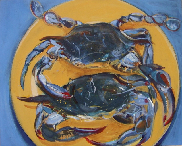 Blue crabs on yellow plate